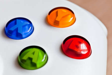 The closeup image of The colorful buttons on the gaming controller photo