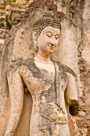 The ruins of a beautiful image of Buddha in a temple, Sukhothai province, Thailand