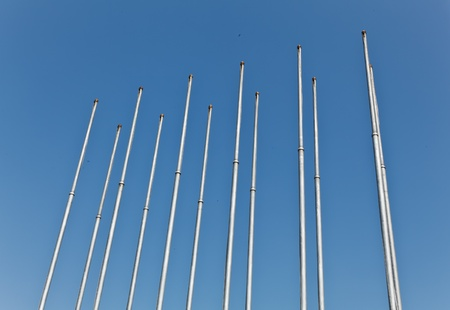 The empty metallic flagstaffs with the clear blue sky background Banque d'images