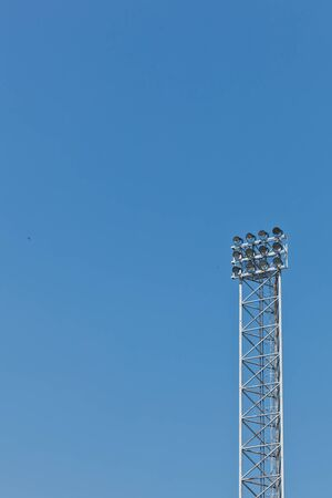 A iron truss structure of sport lights with the clear blue sky background