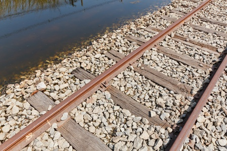 The Flooded Straight Railway Track with Timber Sleepers photo