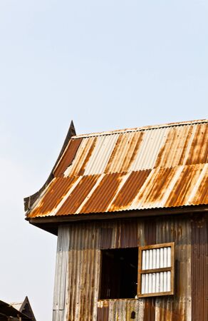 The old Thai style metal sheet house in the countryside of Thailand