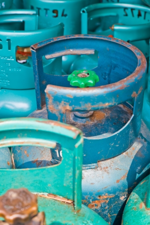 The closeup image of the cooking gas cylinders in a stock