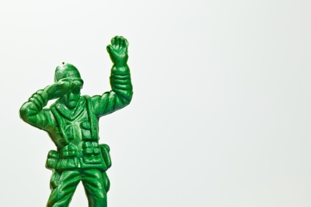 green plastic soldiers: The closeup isolated image of the green toy soldier