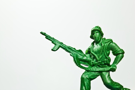 The closeup isolated image of the green toy soldier