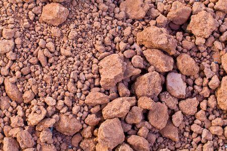 The background image of the pile of dry soil