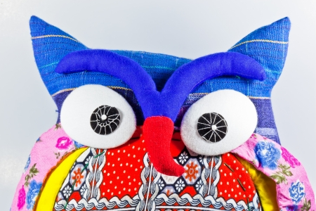 The closeup image of the colorful owl doll