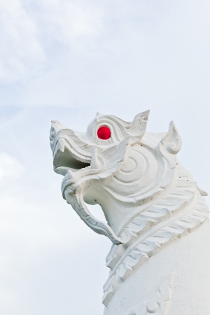 The closeup image of a white guardian singha in a temple of Thailand Banque d'images