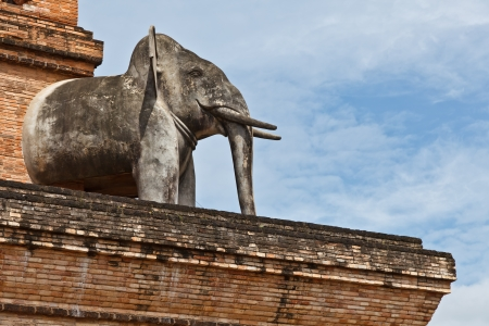 An elephant stands guard midway up the platform of Chedi Luang stupa,Chedi Luang temple, Chiang Mai province, Thailand photo