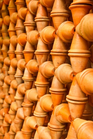 The decorative wall of baked clay pots Stock Photo