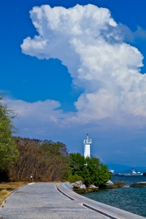 A way along the beach with the white cloud and the clear blue sky