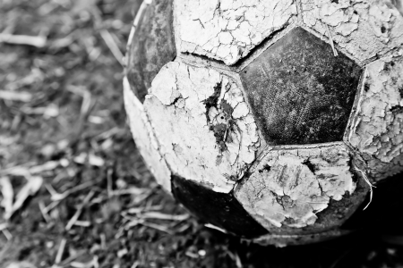 ball field: The closeup image of an old ball on the ground