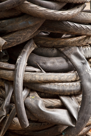 The pile of abandoned inner tubes and motorcycle tyres Stock Photo