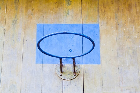 The closeup image of the old basketball hoop without net and the wooden board Banque d'images