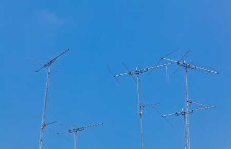 The old style antennas with the clear blue sky