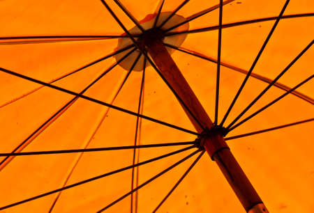 The structures of an old big yellow umbrella