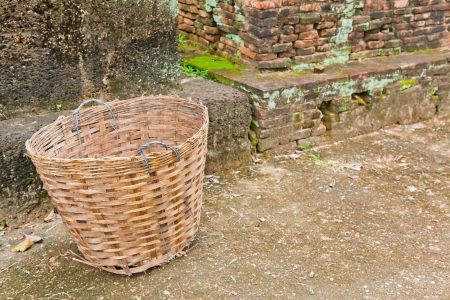 An abandoned empty basket is on the path along the ruins Stock Photo