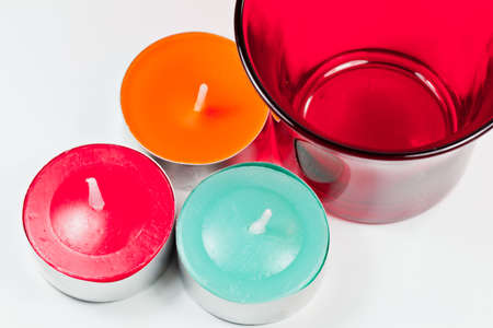 The closeup image of circular candles with the red glass