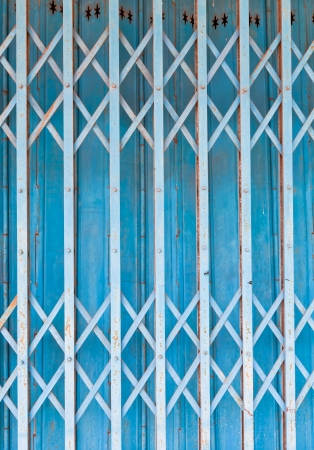 iron curtain: The background image of the old steel shutter