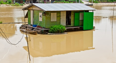 The Thai style houseboat floating in the river, Thailand