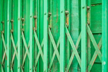 The closeup image of the green metal shutter gate photo