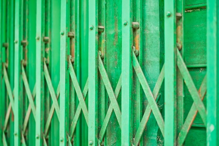 The closeup image of the green metal shutter gate Stock Photo