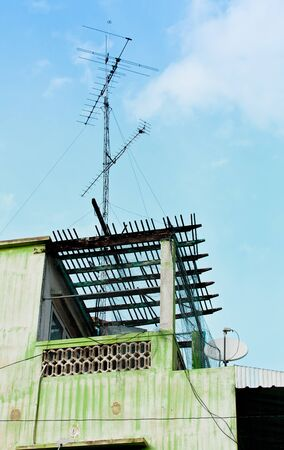 The antenna on the old building in the countryside of Thailand photo