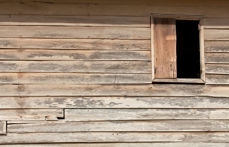 The background image of the old wooden window on the wooden wall Stock Photo