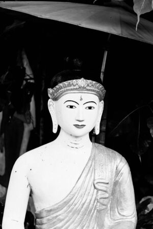 The black and white image of the Myanmar style image of Buddha