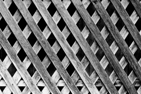The background image of the interwined wooden fence
