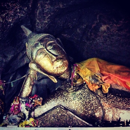 The image of sleeping Buddha in a cave of Thailand