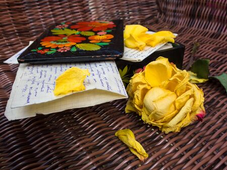 memoir: Letters, painted cascet and wilting rose Stock Photo