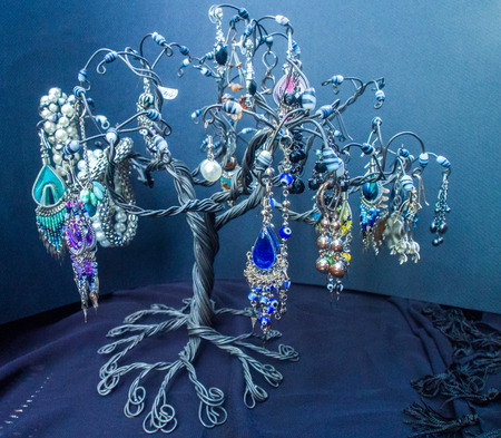 jewerly: Earrings on jewerly tree. Black Background