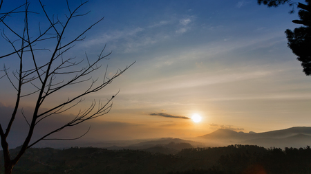 hazy: The Sun is about to set in a hazy afternoon Stock Photo
