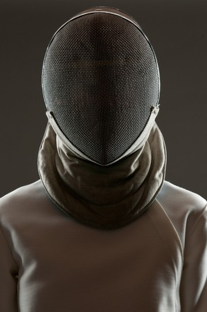 Studio portrait of fencing athlete wearing face protective mask photo