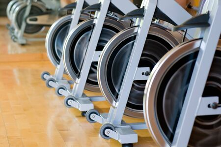 wheel spin: Row of spinning wheels in a modern gym Stock Photo