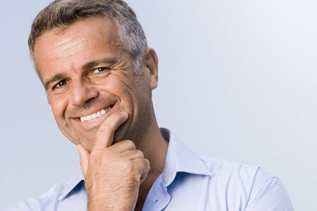 smile close up: Satisfied mature businessman smiling and looking at camera Stock Photo