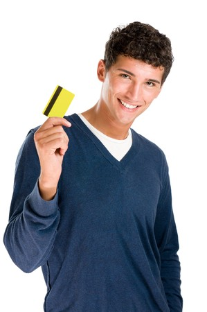 Happy smiling young man showing credit card isolated on white background photo