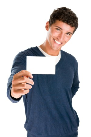 a signboard: Young smiling latin man holding blank white card to write it on your own text isolated on white background