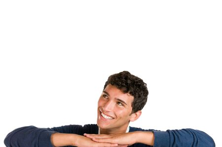 Smiling young man looking up at copy space for your text isolated on white background Stock Photo - 7889355