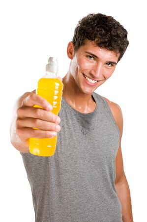 powerful man: Happy young sweated man showing a bottle of energy drink after fitness training isolated on white background Stock Photo
