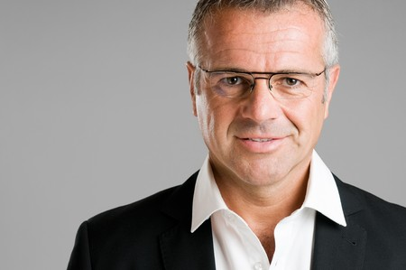 Mature man with eyeglasses looking at camera and smiling photo