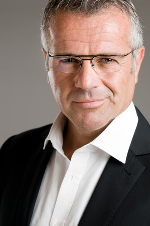 Mature man smile with satisfaction with his new eyeglasses and looking at camera Stock Photo - 7889491