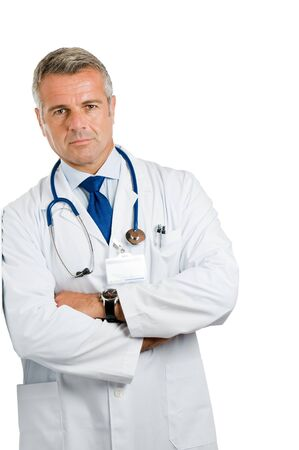Mature doctor standing and leaning isolated on white background*Please note: the Doctor Label is made by myself with a personal design* Stock Photo - 7889359