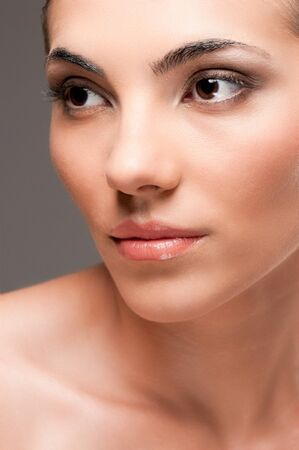 Close up beauty portrait of young beautiful woman with perfect skin and makeup photo
