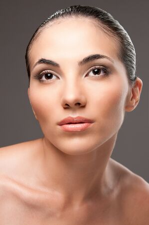 Beauty and fashion female model looking away, perfect skin and makeup photo