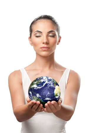 offering: Peaceful beautiful woman holding planet earth with care and responsibility, symbol of environment protection