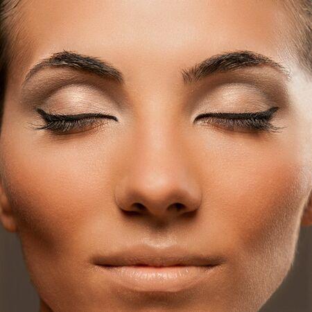Closeup shot of beautiful female model with professional fashion makeup photo