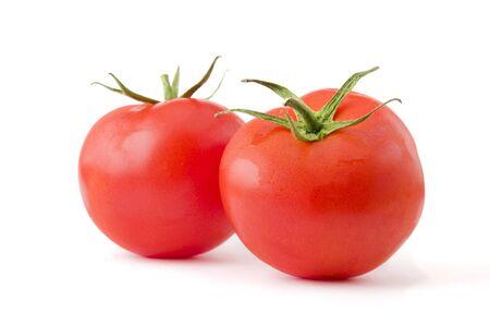 Two fresh and ripe tomatoes isolated on white background. Professional studio image photo