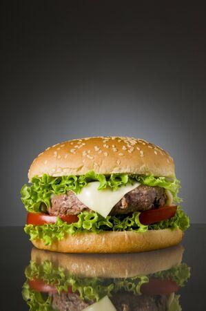 junky: Big fresh delicious homemade hamburger with reflection